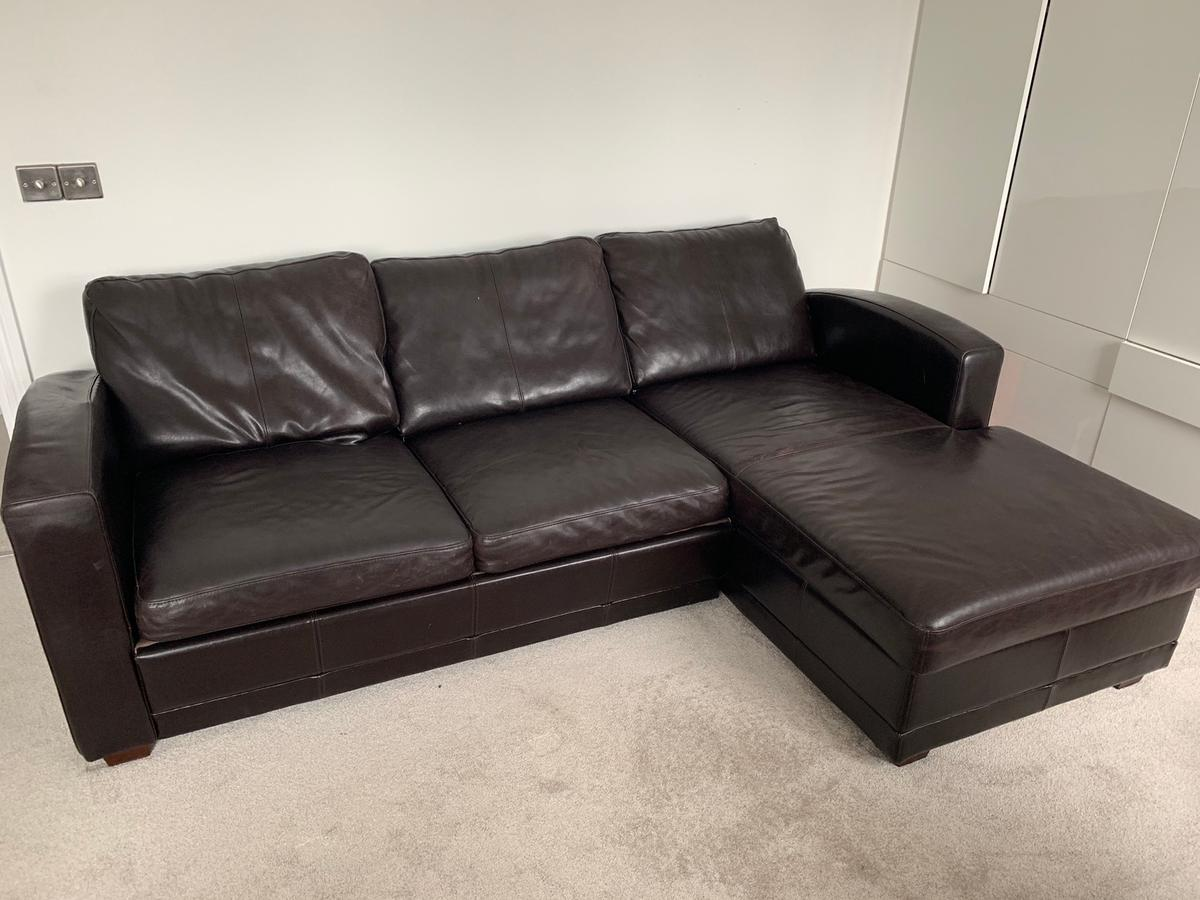Leather sofa-bed with storage