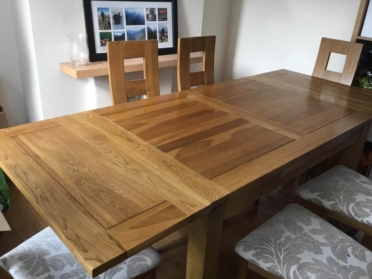 Solid oak extending dining table and 9 chairs in M9 Trafford für ...