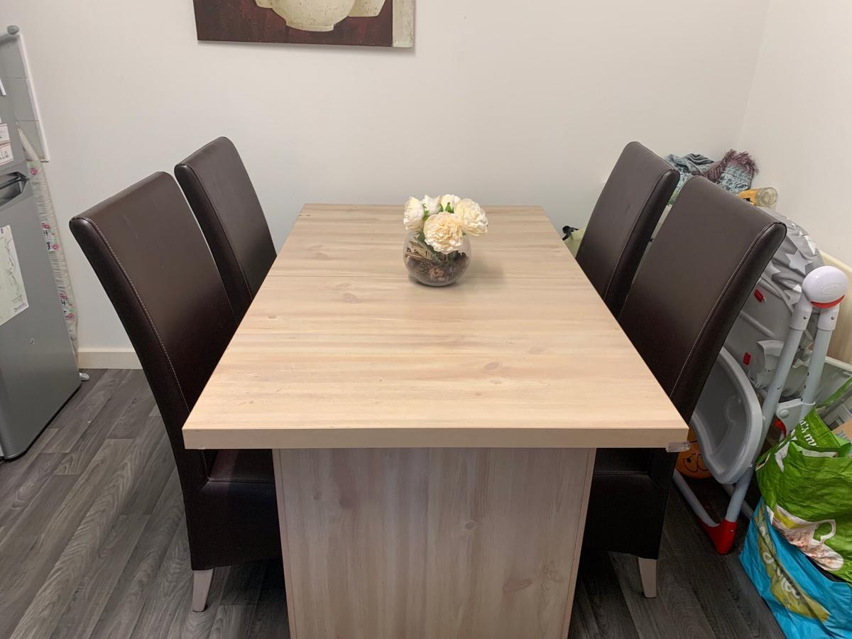 Pine dining table and faux leather chairs in B15 ...