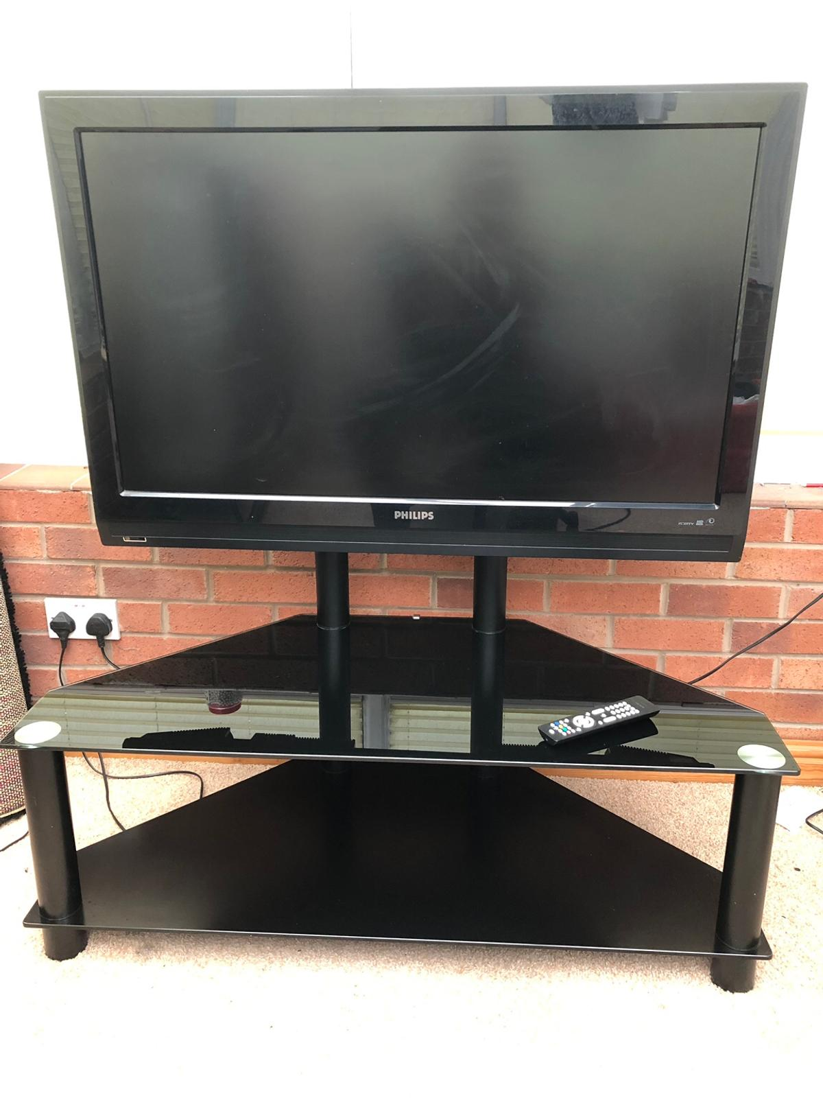 "42"" TV and glass unit"
