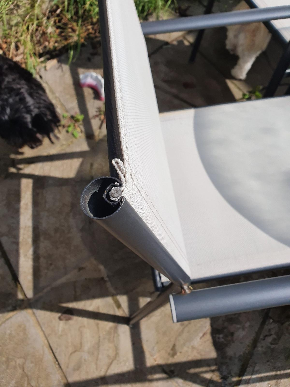 OUT SIDE ROUND TABLE AND 4 WHITE CHAIRSI