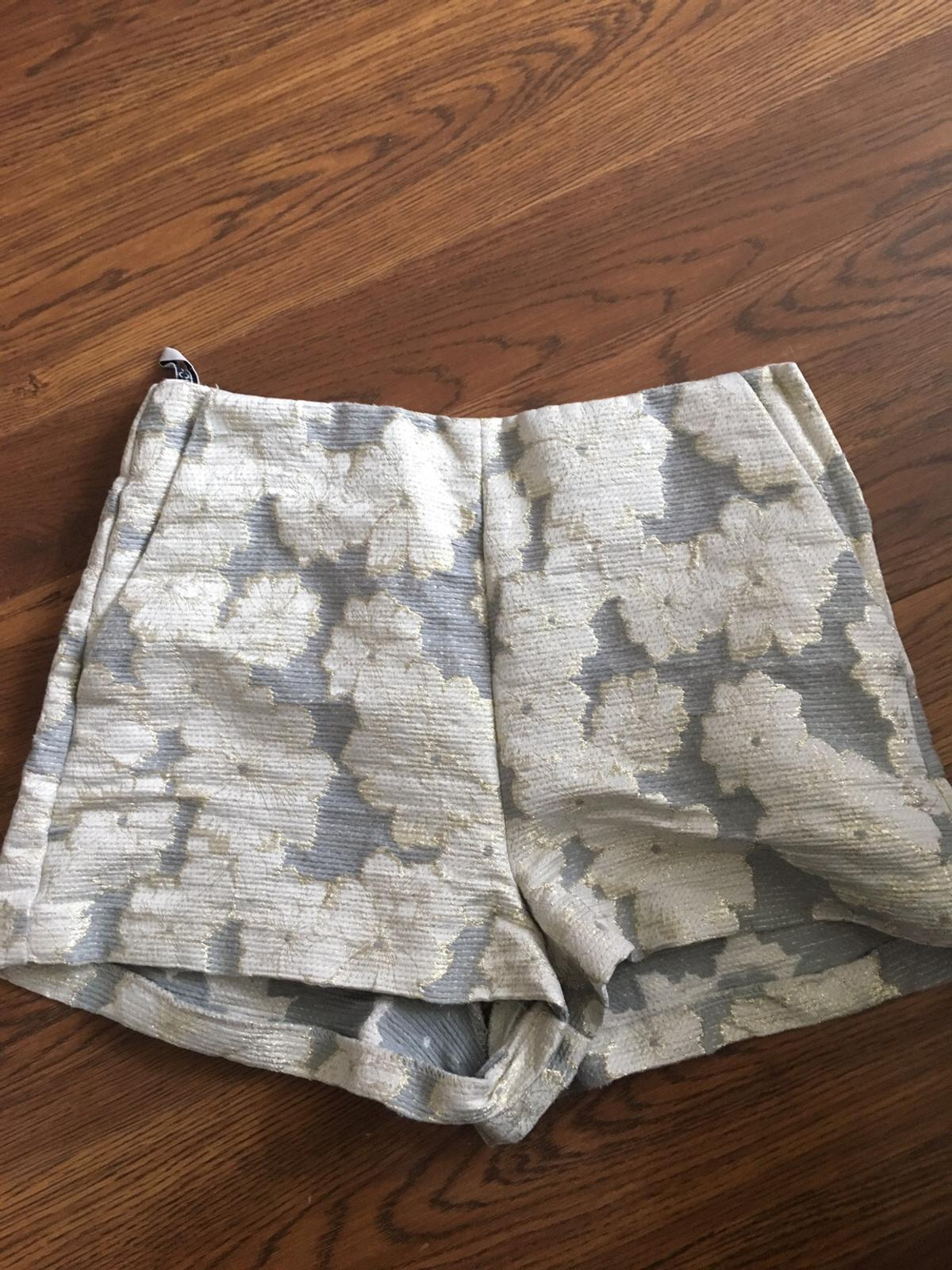 Lovely shorts from Top Shop Size 10 From a smoke and pet free home.  Please check my other listings..