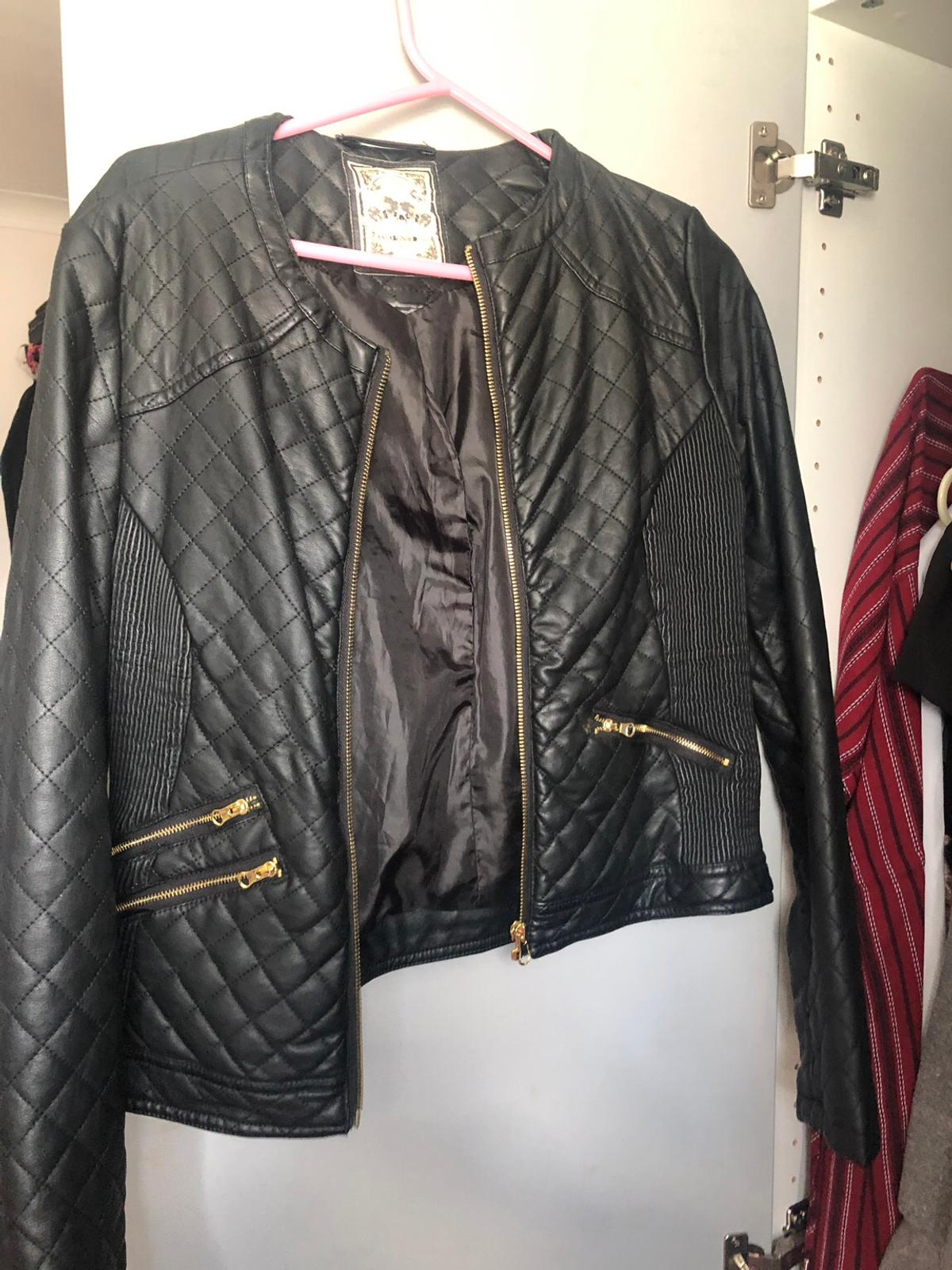 Beautiful size 12UK faux leather jacket, in a quilted style. Great condition. Suits all shapes due to the elasticated bit under the arms.  Sensible offers only.