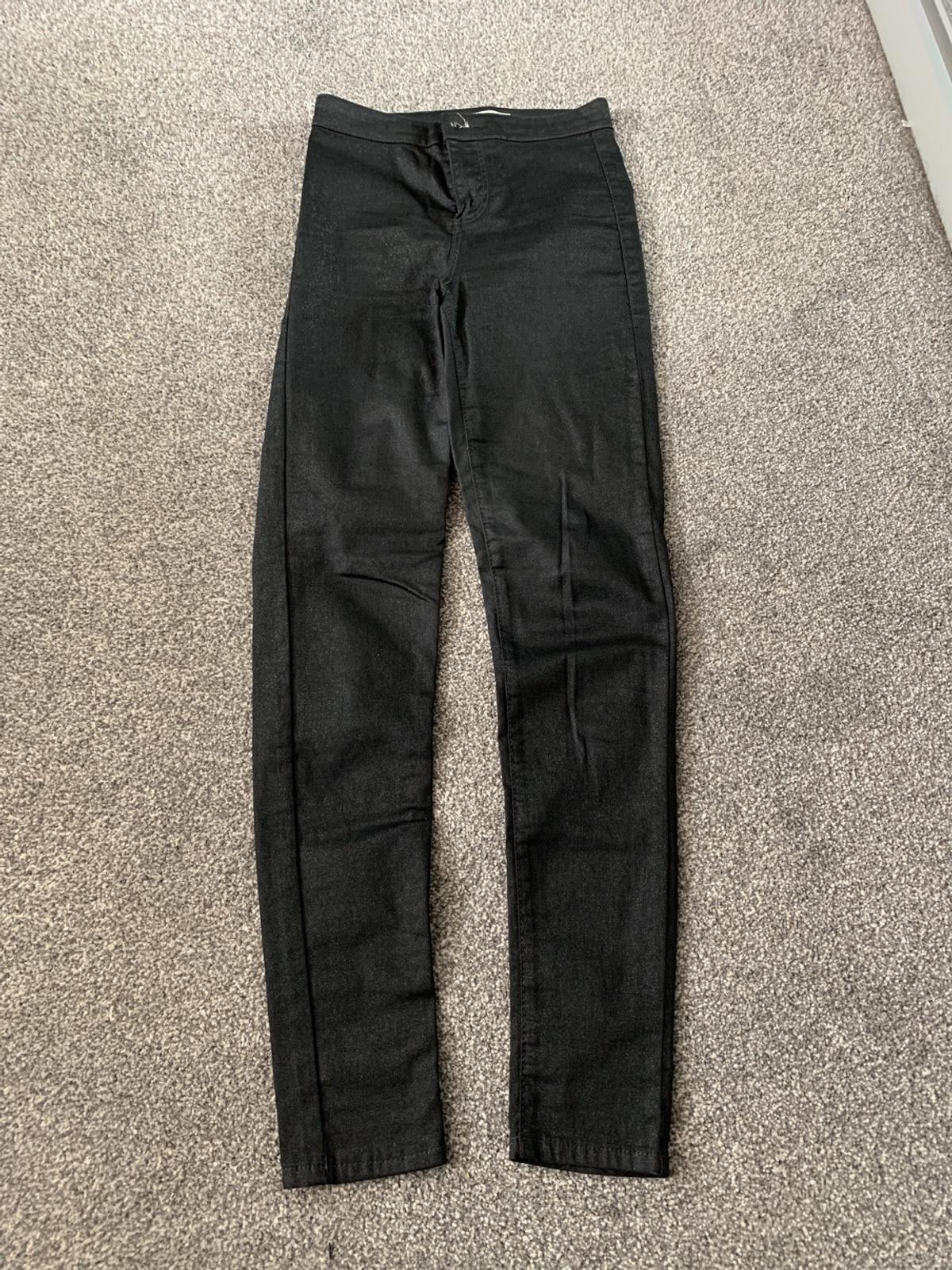 Black Topshop Joni Jeans Size W:26 L:32. Base of Jeans is black with glitter effect.