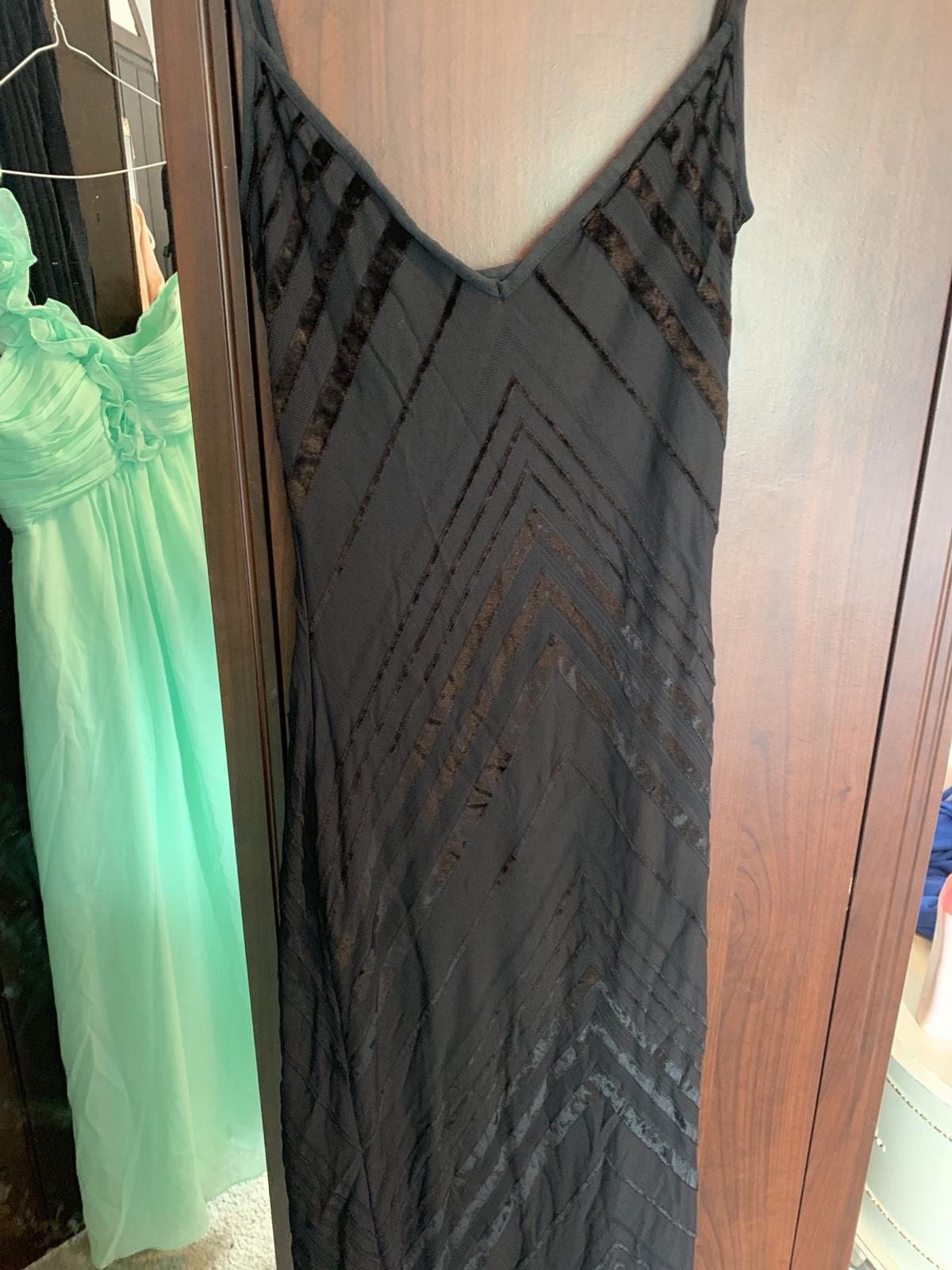 Amazingly flattering size 8 dress .  I wore for my graduation ball.  Fully lined  Cost £150  Very heavy so postage would be £7/8  Collection from upper Arley  Welcome to try on  Can possible deliver for a fee