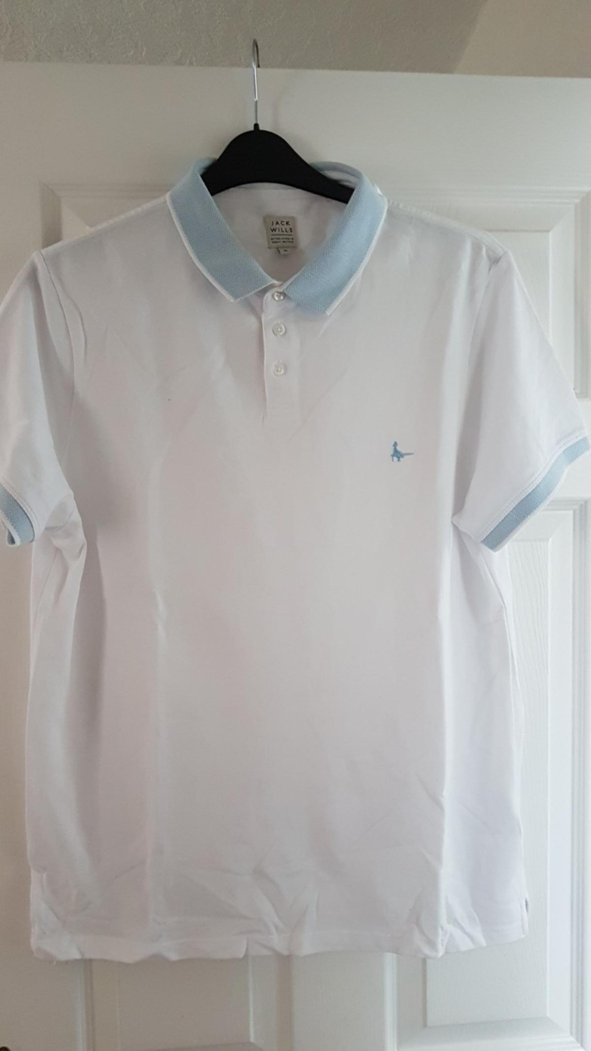 white with pale blue collar and sleeve edges. size XL. hardly worn. from pet free and smoke free home. collection only. mere green area .