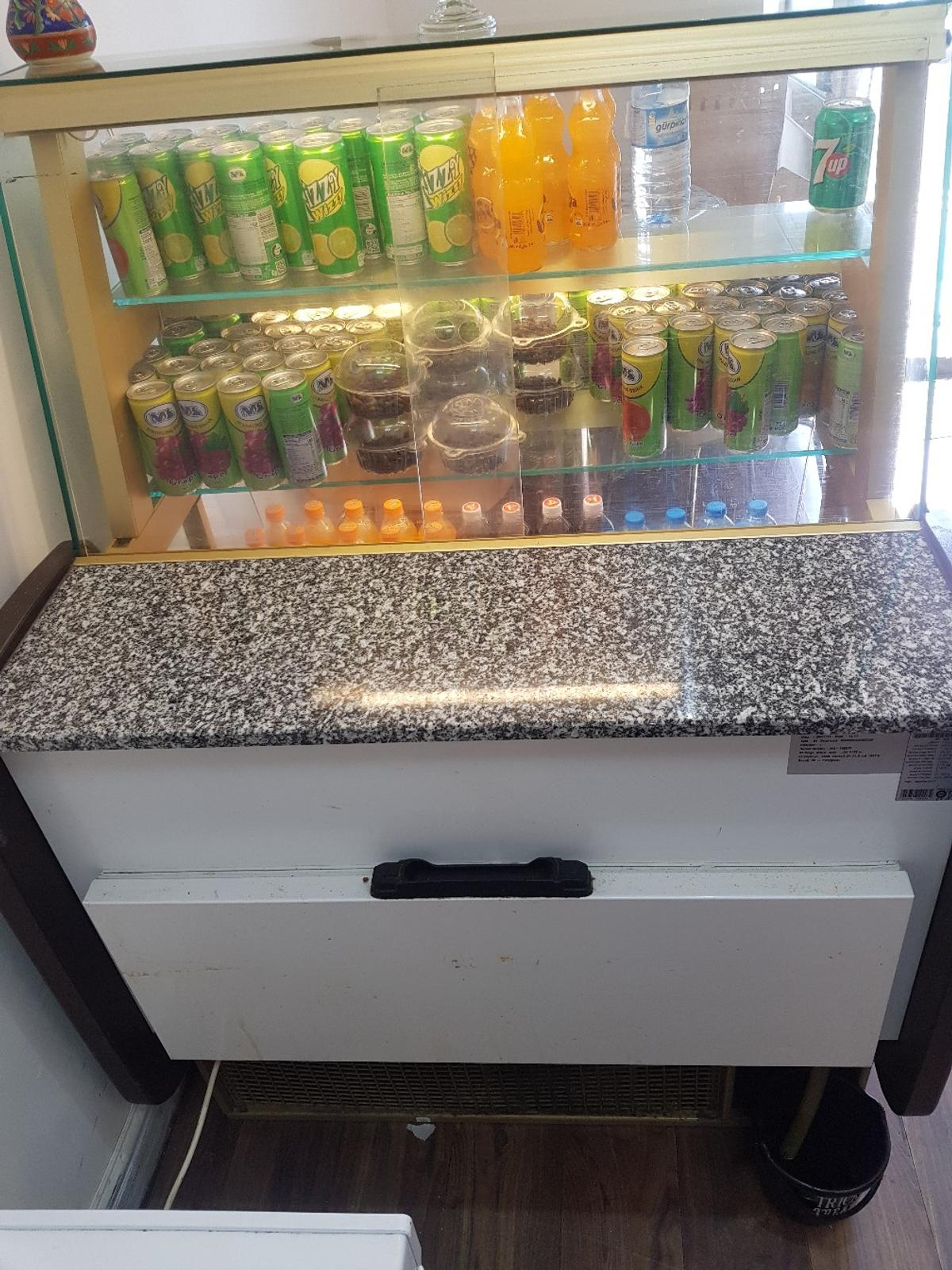 this fridge is working perfectly fine is a cooler and drink display I'm selling it because I need a smaller one . for information call me on 07728801875