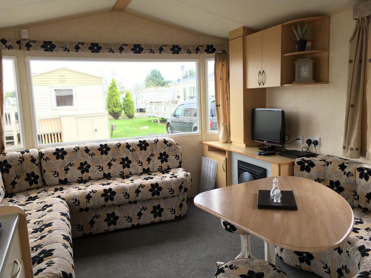Our 3 bedroomed caravan is sites on The Elms, Southview Leisure Park is a Parkdean resort and has all the amenities of a fun filled family holiday park. PLEASE BOOK THROUGH - 2cholidays 01362 470888 Ref: 33014 The Elms FROM £60 PER NIGHT Our caravan is 3 bedroomed, one double and two twin bedded rooms, and a pullout sofa bed. Maximum occupancy of 8 people Entry into kitchen and lounge/diner. Lounge with TV, DVD player, gas fire, double sofa bed and dining area
