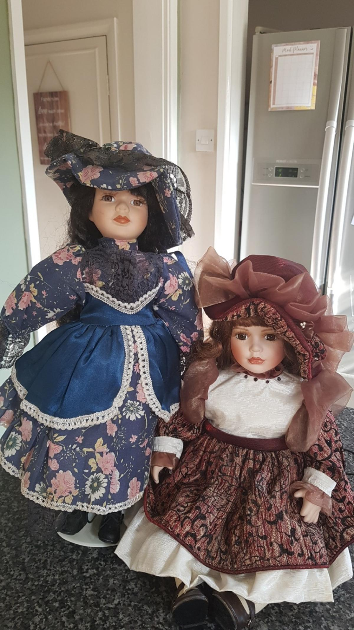 Both in excellent condition. The young lady in blue is named Alice.