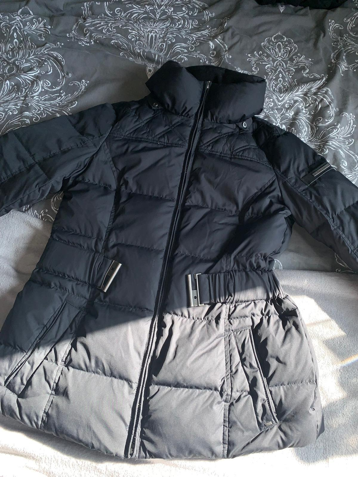 Size 12. bought from fenwicks. With detachable hood. Belt doesn't fasten as metal on one side is bent. Open to offers