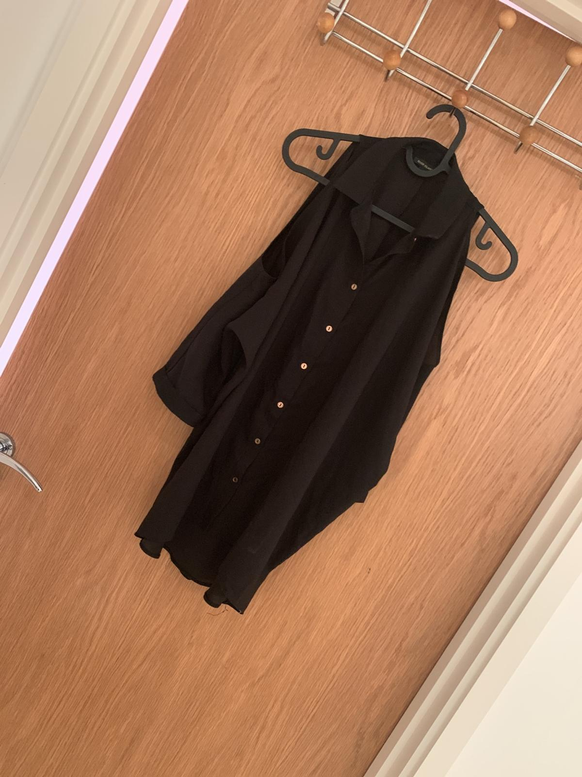 River island black shirt Open sleeve and open back  Size 6 but fits meet as a 14 coz the back is open Comfortable to wear as relaxed fit