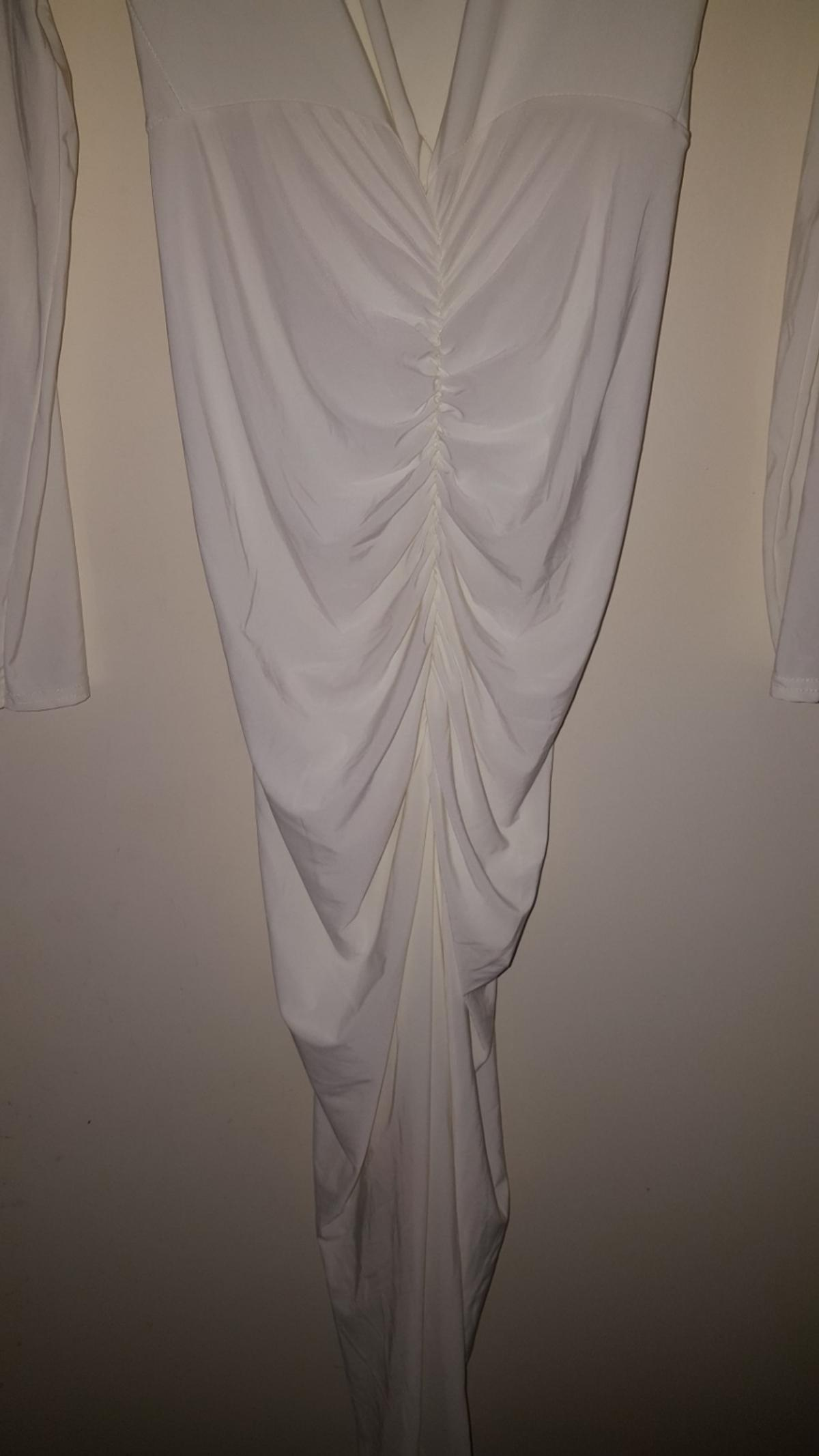 Pretty Little Thing Womens White Dress Size 10. V-Drop Front with Ruffle Bottom. Never been worn. Immaculate condition. Collection only - postage is an additional cost chargeable to buyer.