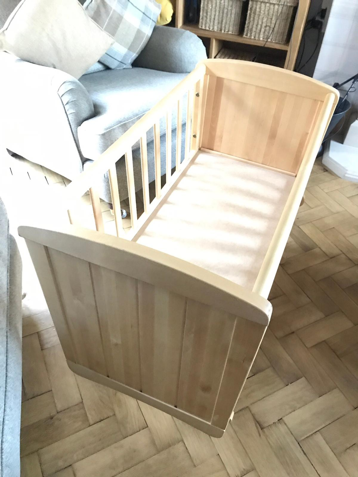 Excellent condition. Good quality solid crib. Gliding rocking action. Mattress included.