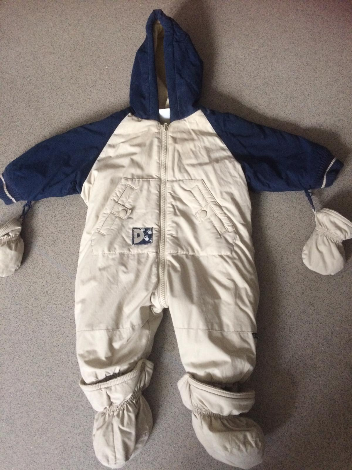 3-6mths snow suit with mittens.  On other selling sites