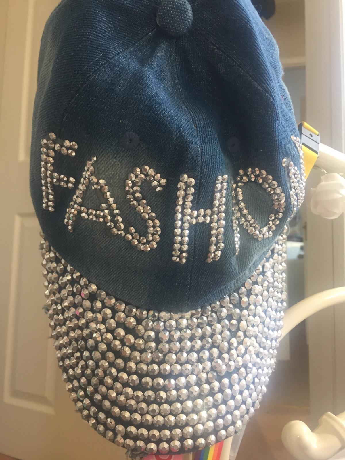 'Fashion' and 'Kiss' denim caps with diamond accessories. Can be sold together or separately. Price for both- £4 Price for one- £3