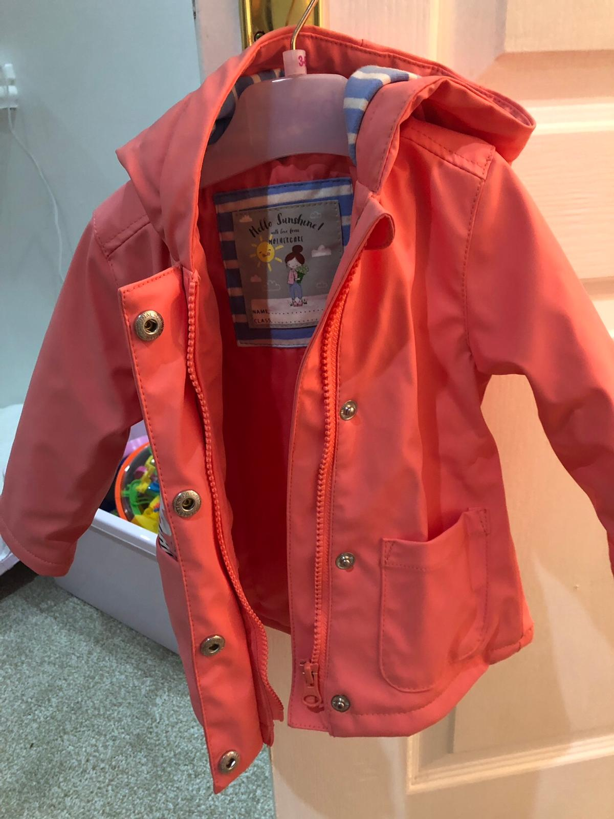 Mother care babies rain coat Excellent condition worn once or twice max