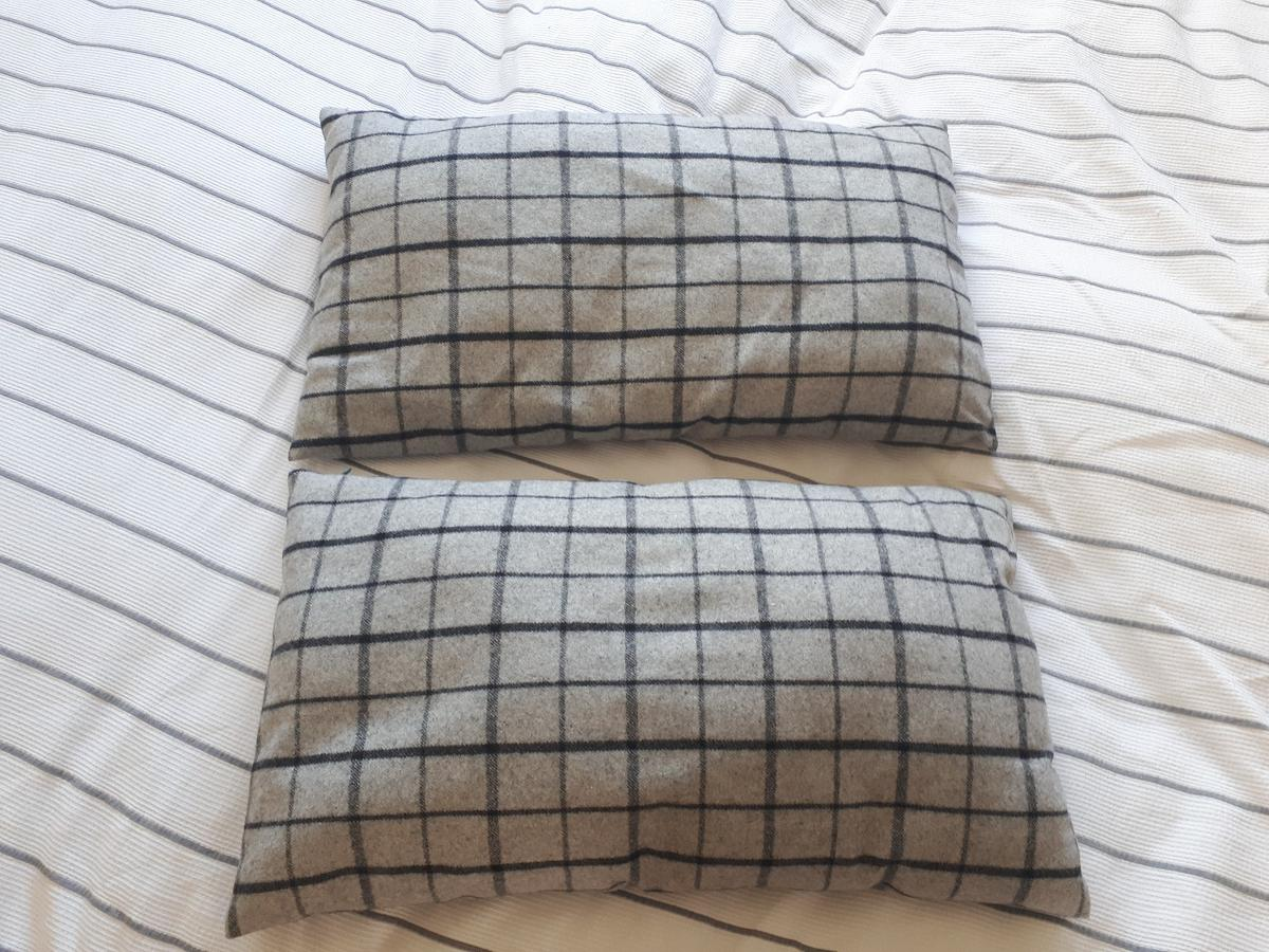 Wool cushions, excellent condition. £10 for both