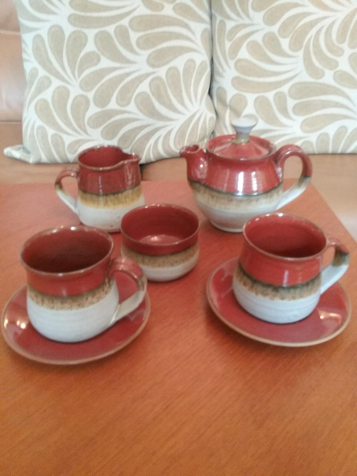 Lovely pottery Coffee teaset for 2 .Will post at cost, Could deliver within the Haydock or Blackpool areas