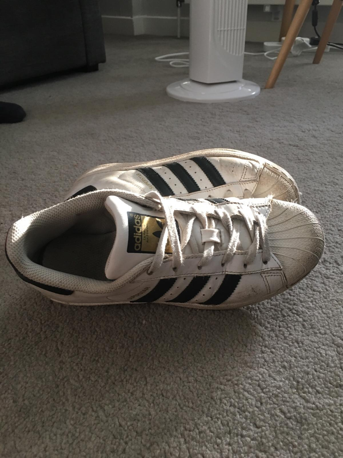 Size UK4 Great condition - white shoe with black stripes. Pay for delivery. Will wash laces before I send. Open to offers