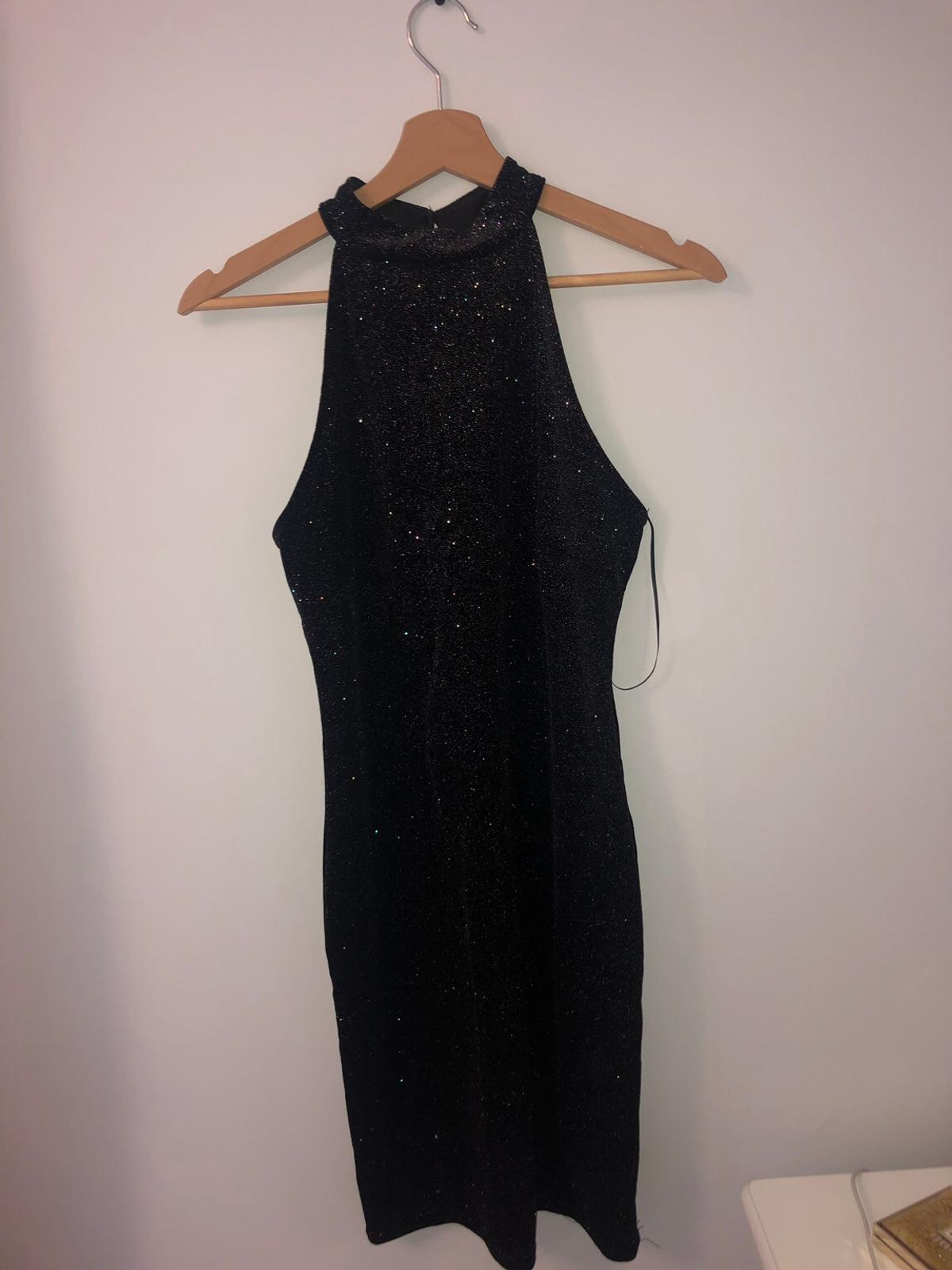 Sparkly high neck line dress from new look. Only been worn once. Very flattering. Very good quality. UK 12.