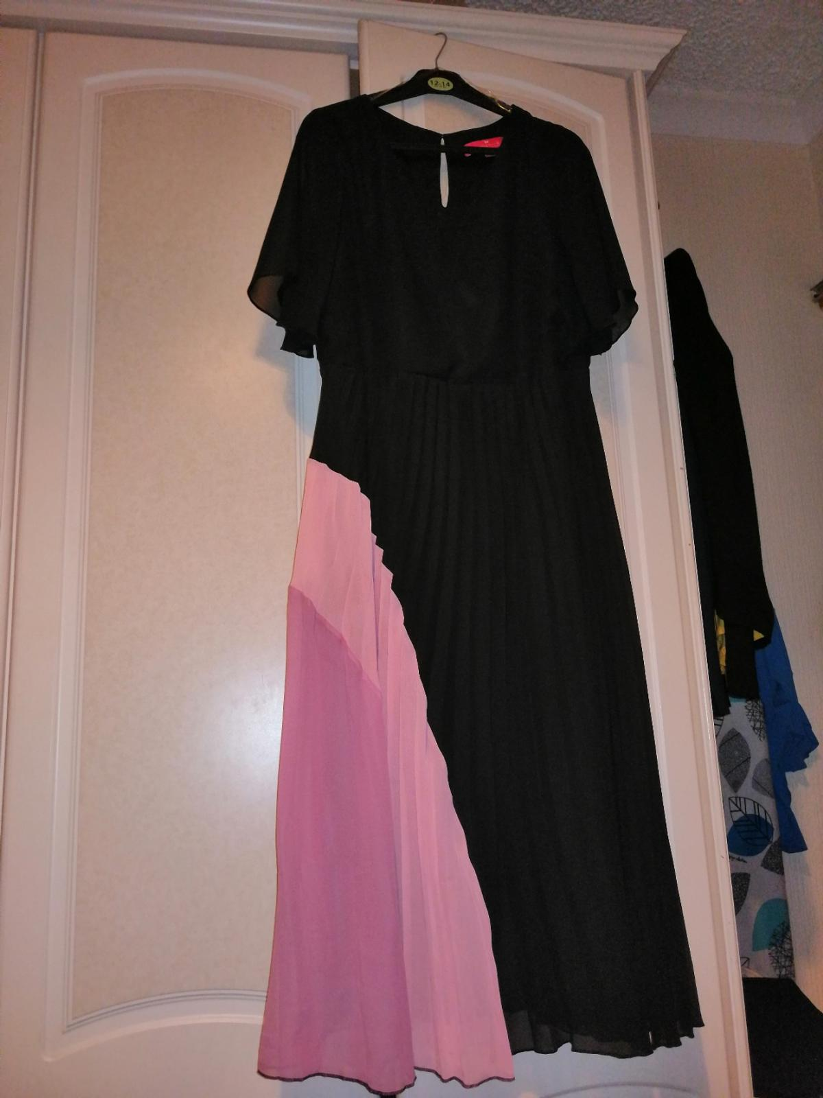 Together black chiffon pleated dress with 2 shades of pink Worn once a few pleats have come out Lovely dress on Was £79 sell for £35