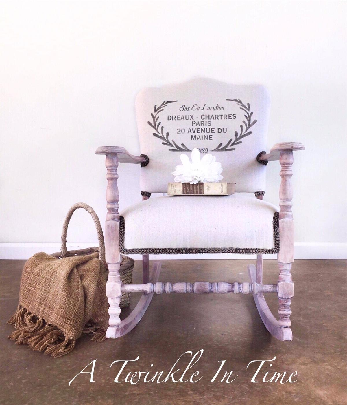 """This vintage wooden rocking chair has an updated look, and would be a great addition to any room in your home, especially a living room, bedroom or nursery. It's padded seat and back are sure to provide the ultimate in comfort. The neutral colors and stenciling give the chair a French country feel that would compliment any decor.  Dimensions: 33""""h x 25""""w x 31""""d  Delivery and nationwide shipping available for an additional fee.  We accept cash and credit cards and lay-away.  Find us on Facebook"""