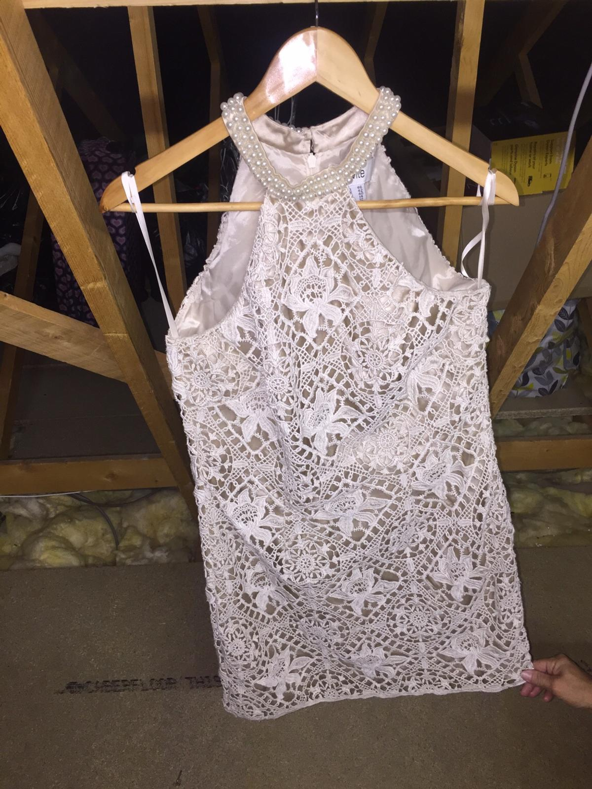 Size 10 to 12 cream and Nude lace dress with cream pearls around the neck like bran new only been wore ones