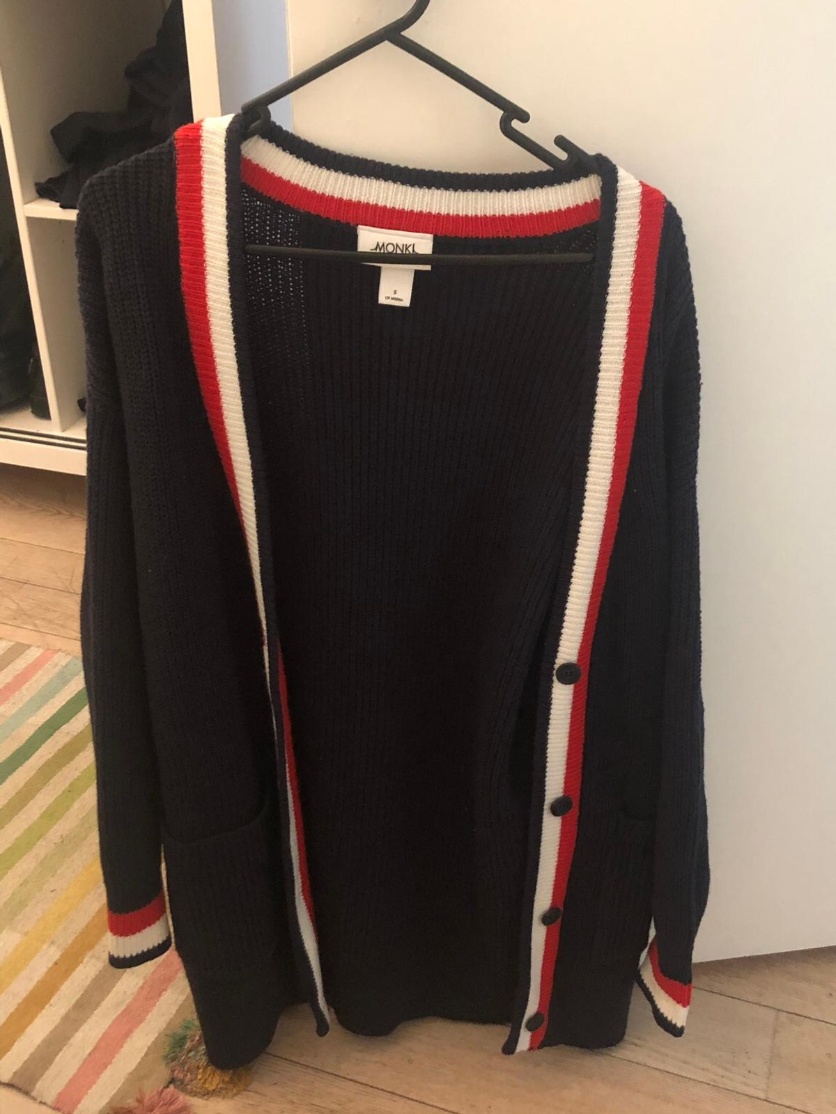 Never been worn navy cardigan with white, red stripe detail. Size small. Really cosy! I bought it last year & found another one soon after.