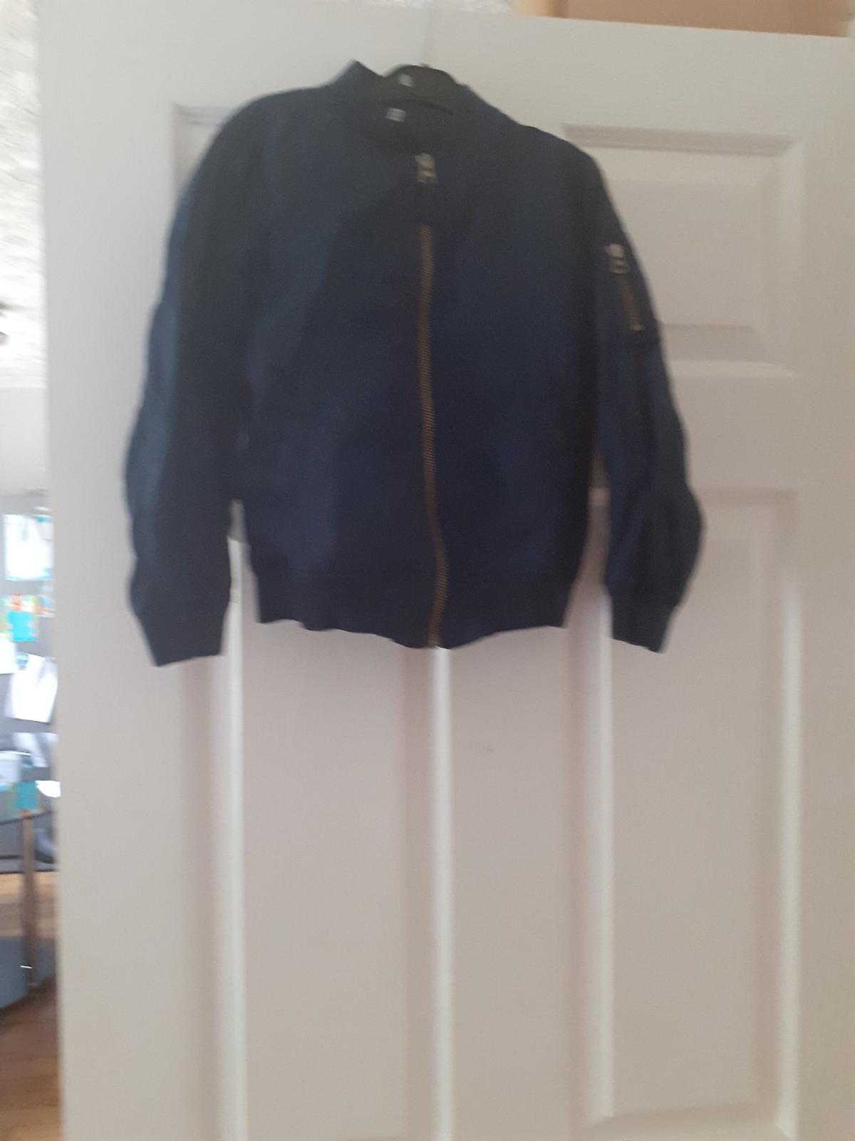 Blue bomber style jacket, aged 4-5 years. In good condition
