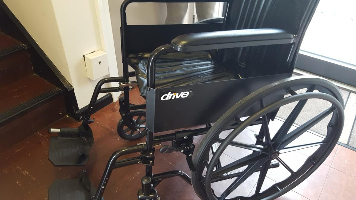 lightweight, self propelled folding wheelchair. only used once