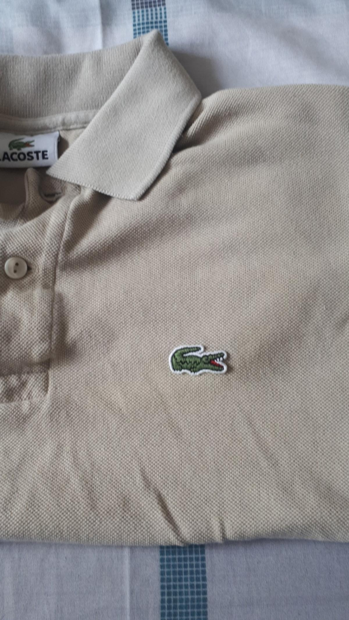 never worn lacoste polo shirt beige in colour. size medium.