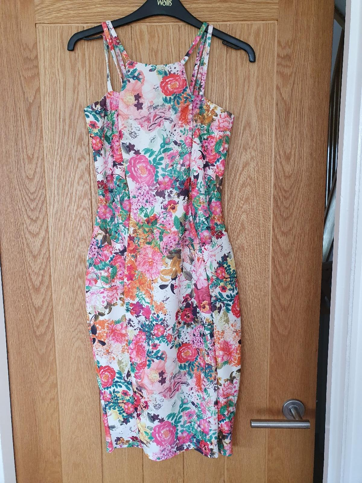 Quiz, floral, size 8 dress. Worn once. Excellent condition. From a pet and smoke free home