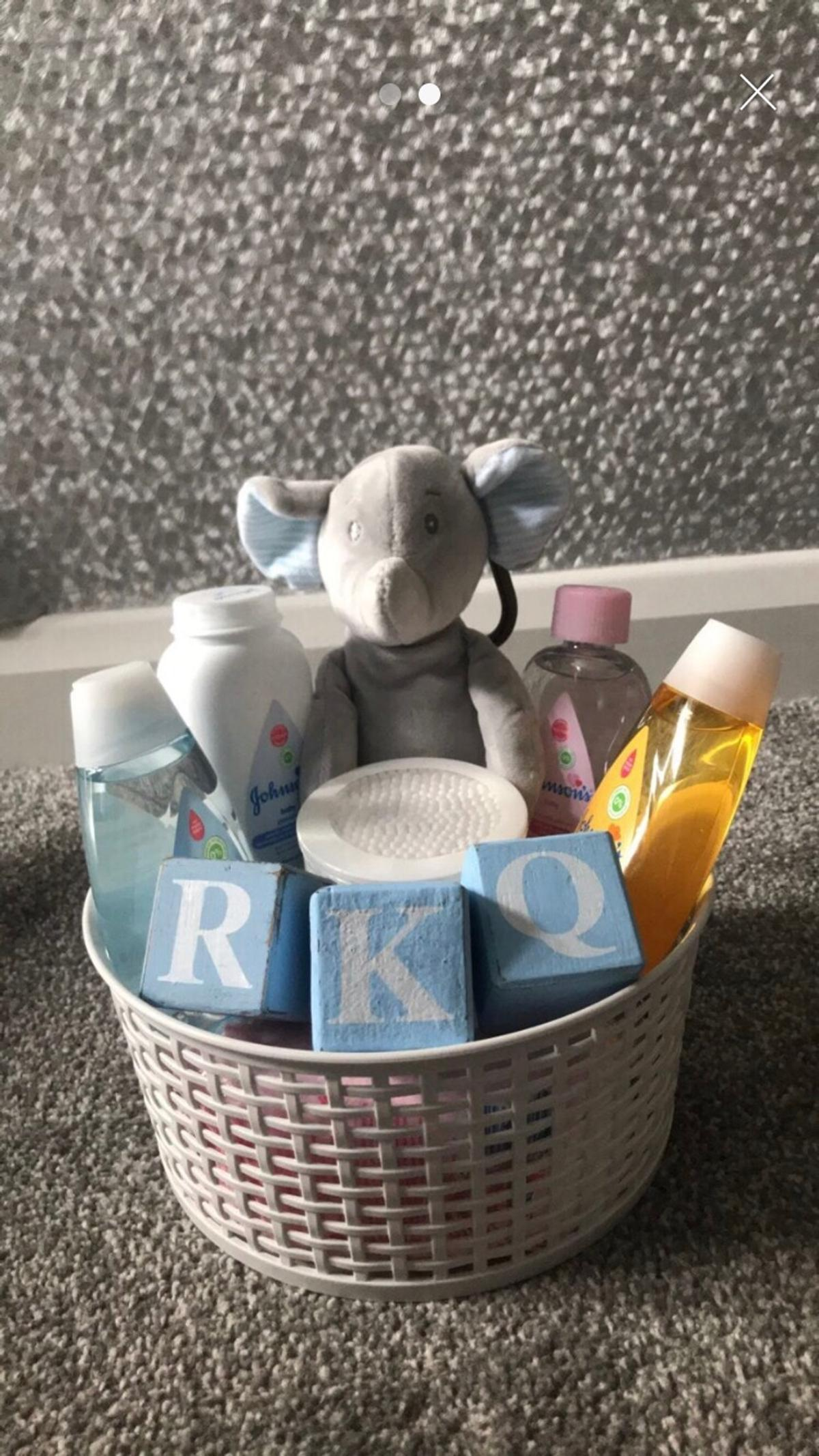 Small hamper basket £15 plus £1 per letter if wanted. Includes.. 1 x rattle teddy, 4 x toiletries, 1 x cotton buds, 1 x cotton pads, 1 x baby wipes, 1 x Muslin. Extras can be added such as photo frame or extra baby gifts for additional cost.