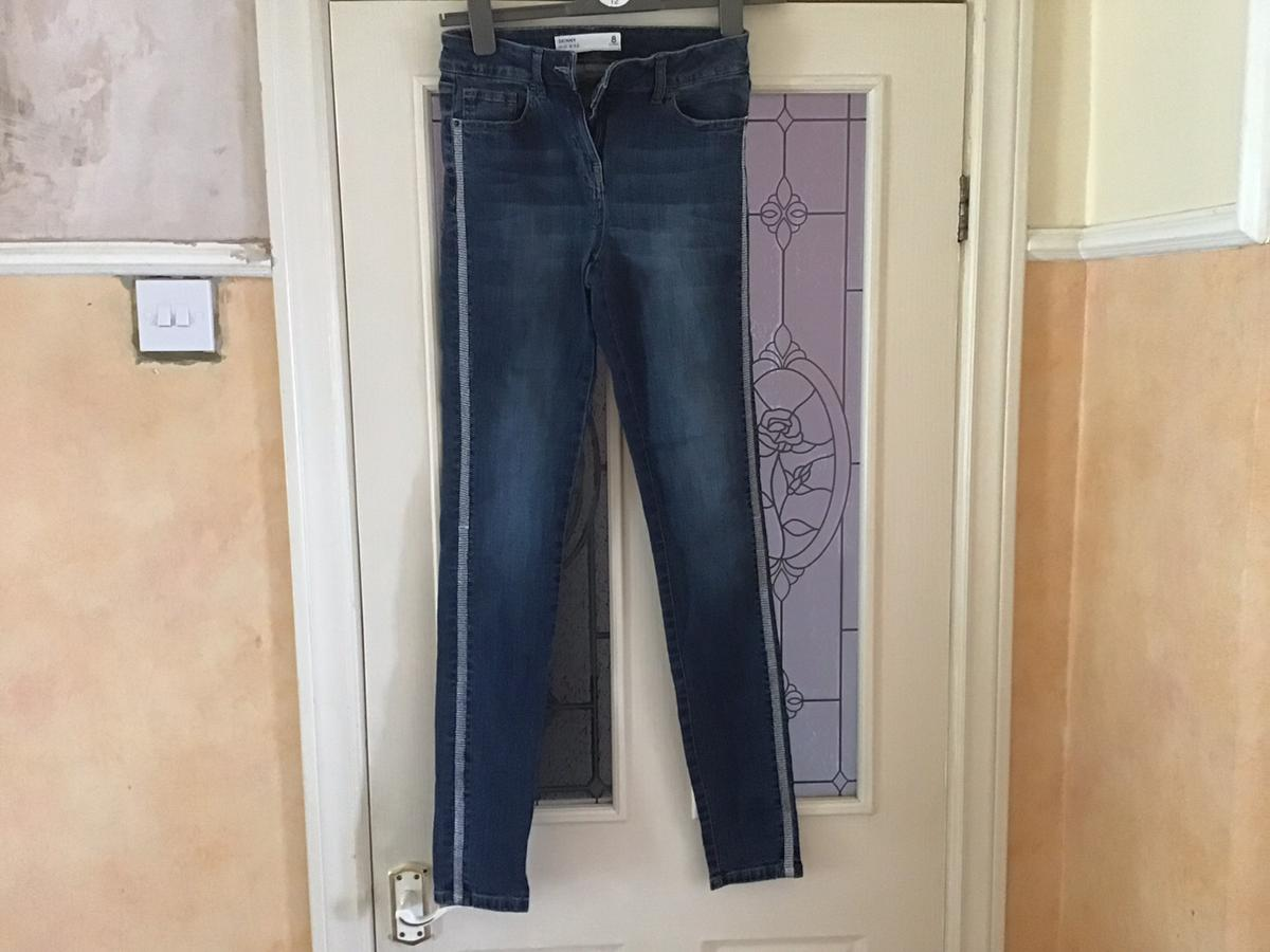 Only wore once in very good condition Very nice jeans with sliver stripes down The side of the legs just having a good sort out please note can't meet as I am a carer for my mum buyer collect will post at extra cost