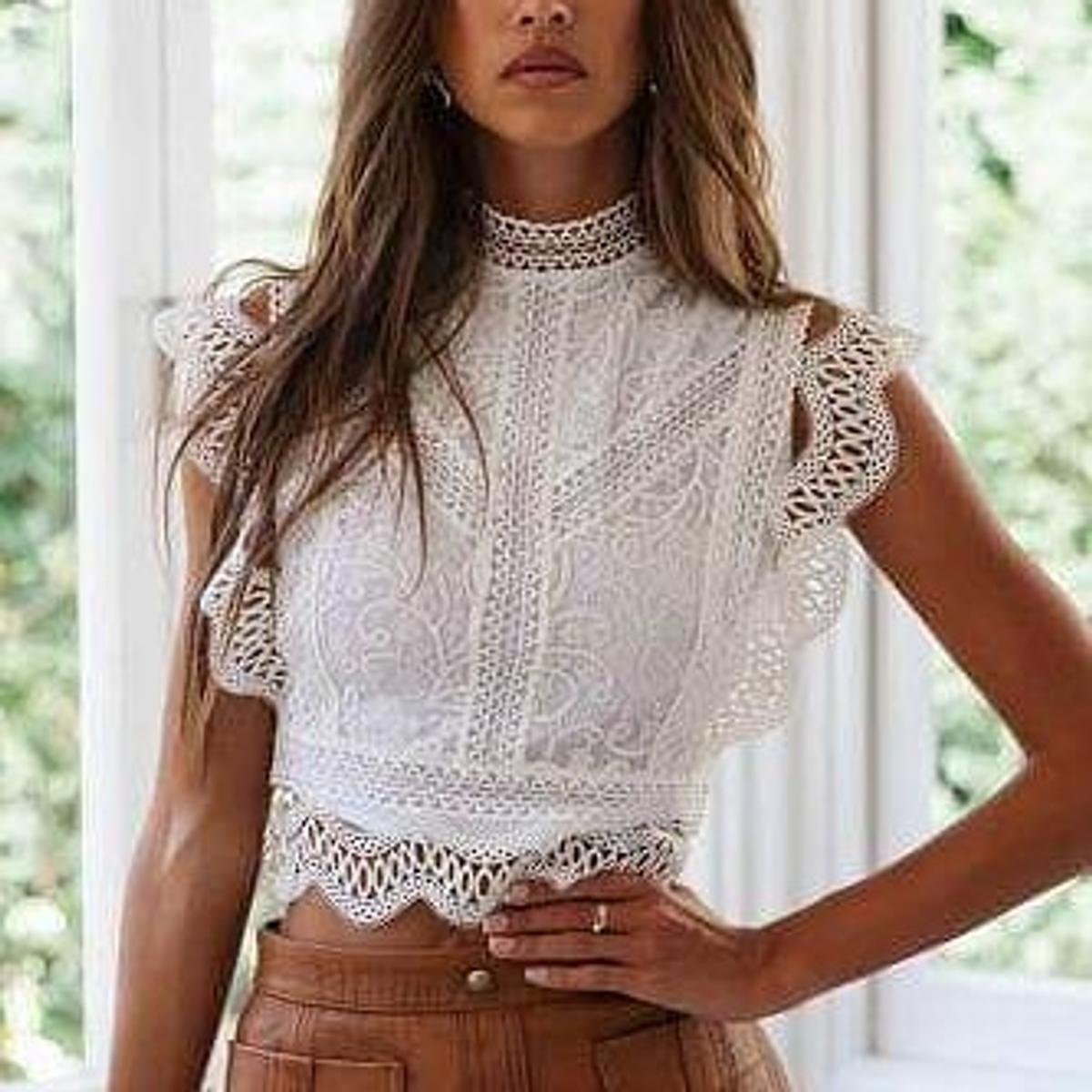 Striking lace and embroidery details, high neck, vintage look cropped top with rear zip facing Colour White Black Size 8/10 12/14 16/18 20/22 bu