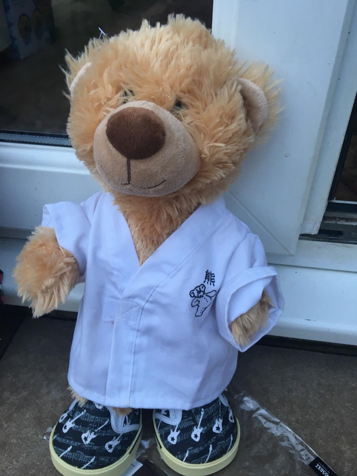 Birthday bear plays song with clothes and trainers great condition