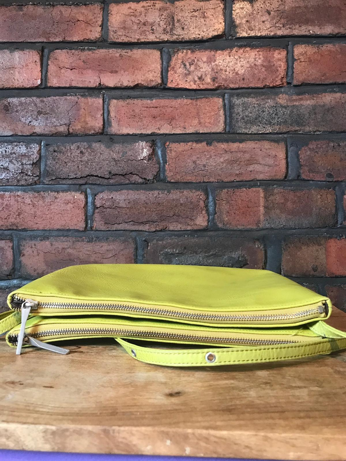 Matt and Nat bag. 100% vegan. Lining made from recycled plastic bottles. Lime green. Minor marks and some wear but still in very good condition.