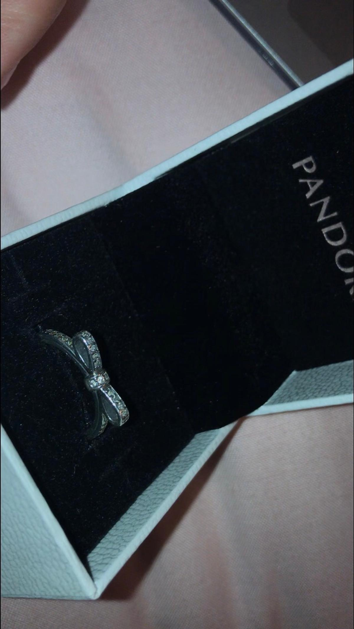 "Stunning Pandora's ""Delicate Bow"" ring in perfect condition. Has minimal scratches from usage, but i couldn't get them on picture as they are so small - not noticeable at all. Size 50. RRP £50  📦free delivery📦"