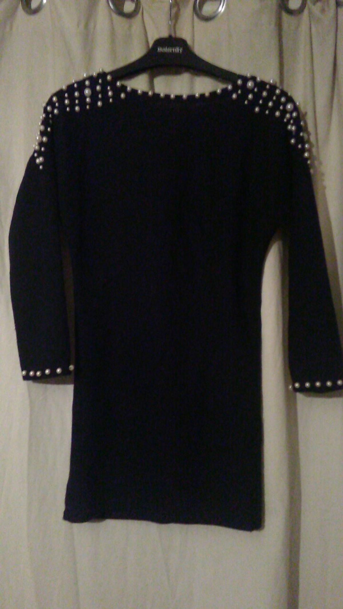 Cut out back with beading detail , worn once..