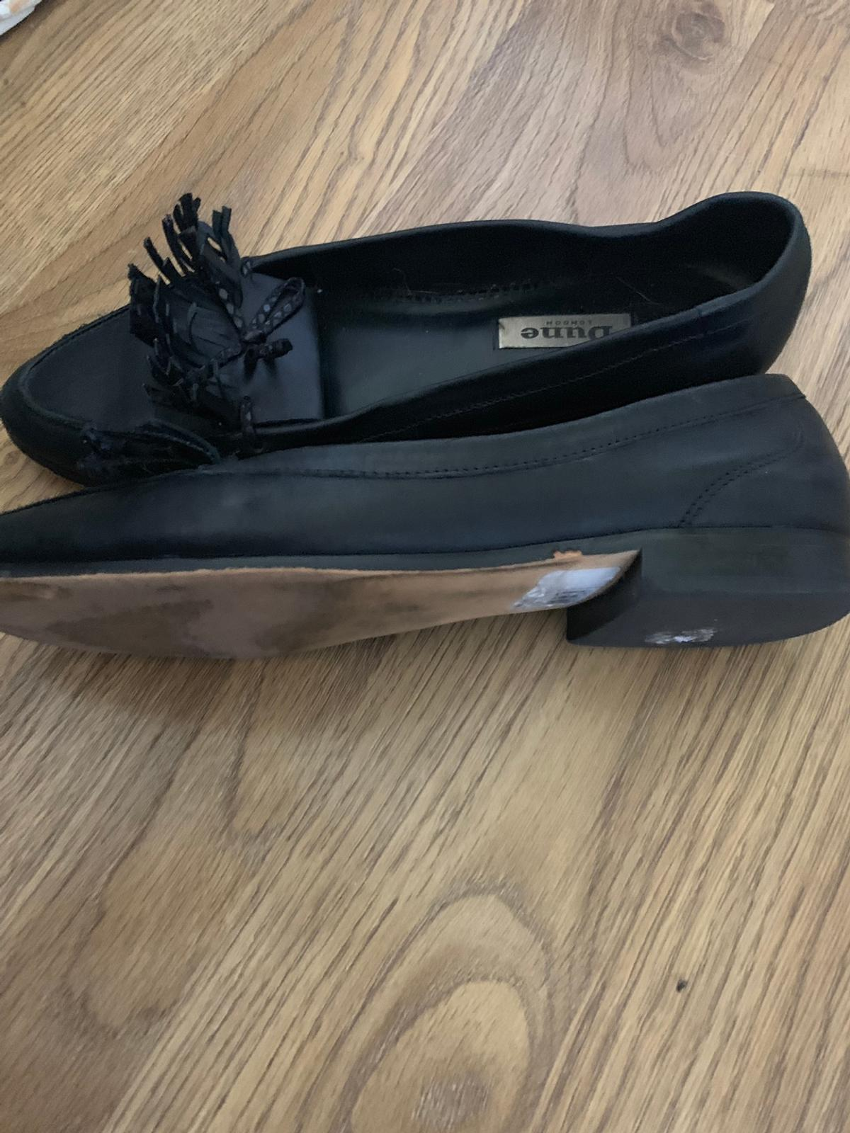 Retail brand is Dune  Size 5.5.  Real leather and good quality.  Worn.