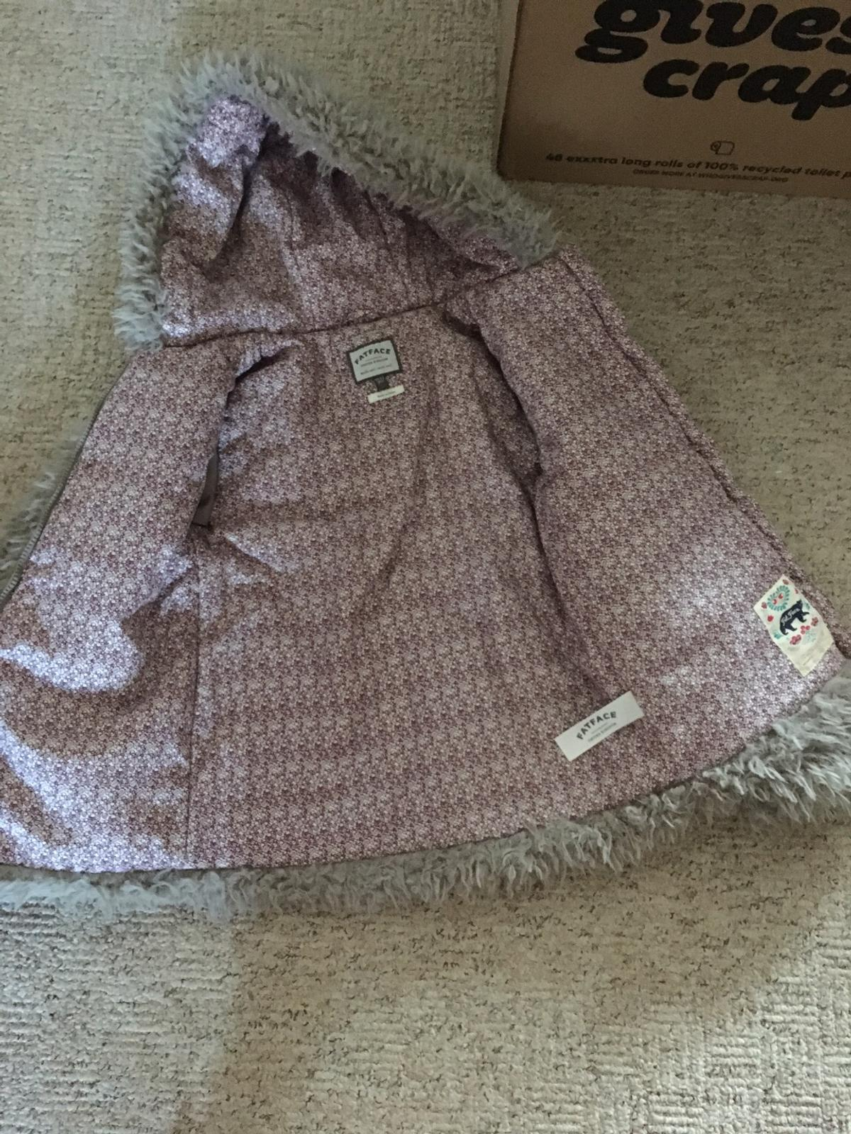 Girls 10/11 winter jacket from Fatface Cosy and fluffy Padded lining Pockets and hood. VGC