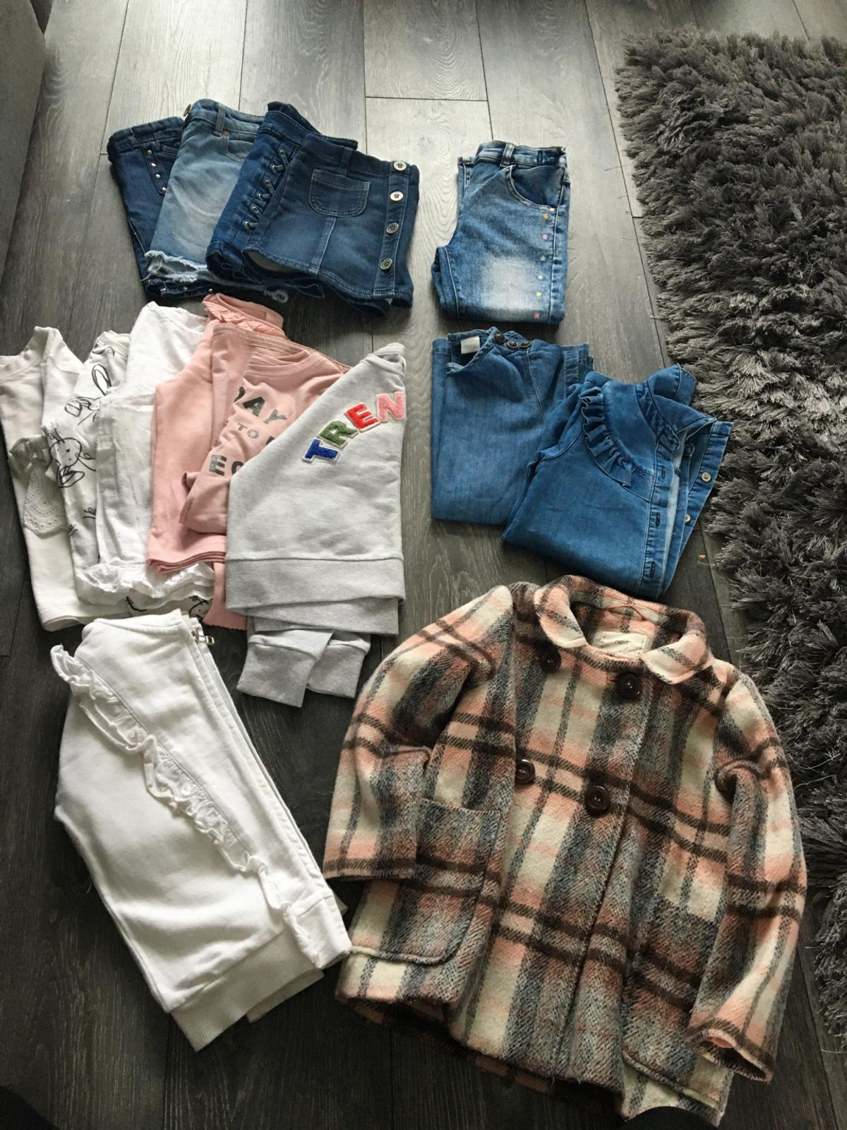 All from next in great condition 4 denim skirts Checked coat White hoody Trending jumper Jeans Two denim dresses Five tops