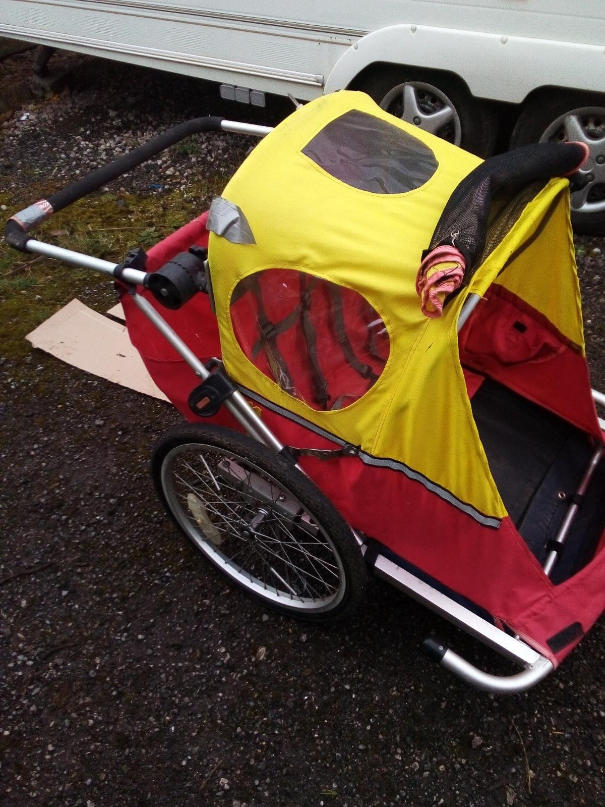 unbranded child bike trailer with hitch bar, all folds flat for ease of storage. two obvious damage areas around each side of the hinge but otherwise a tidy trailer. both wheels straight and true. comes with jockey wheel for USD as pram. will take two small children or one big one. collection from l36 area preferred
