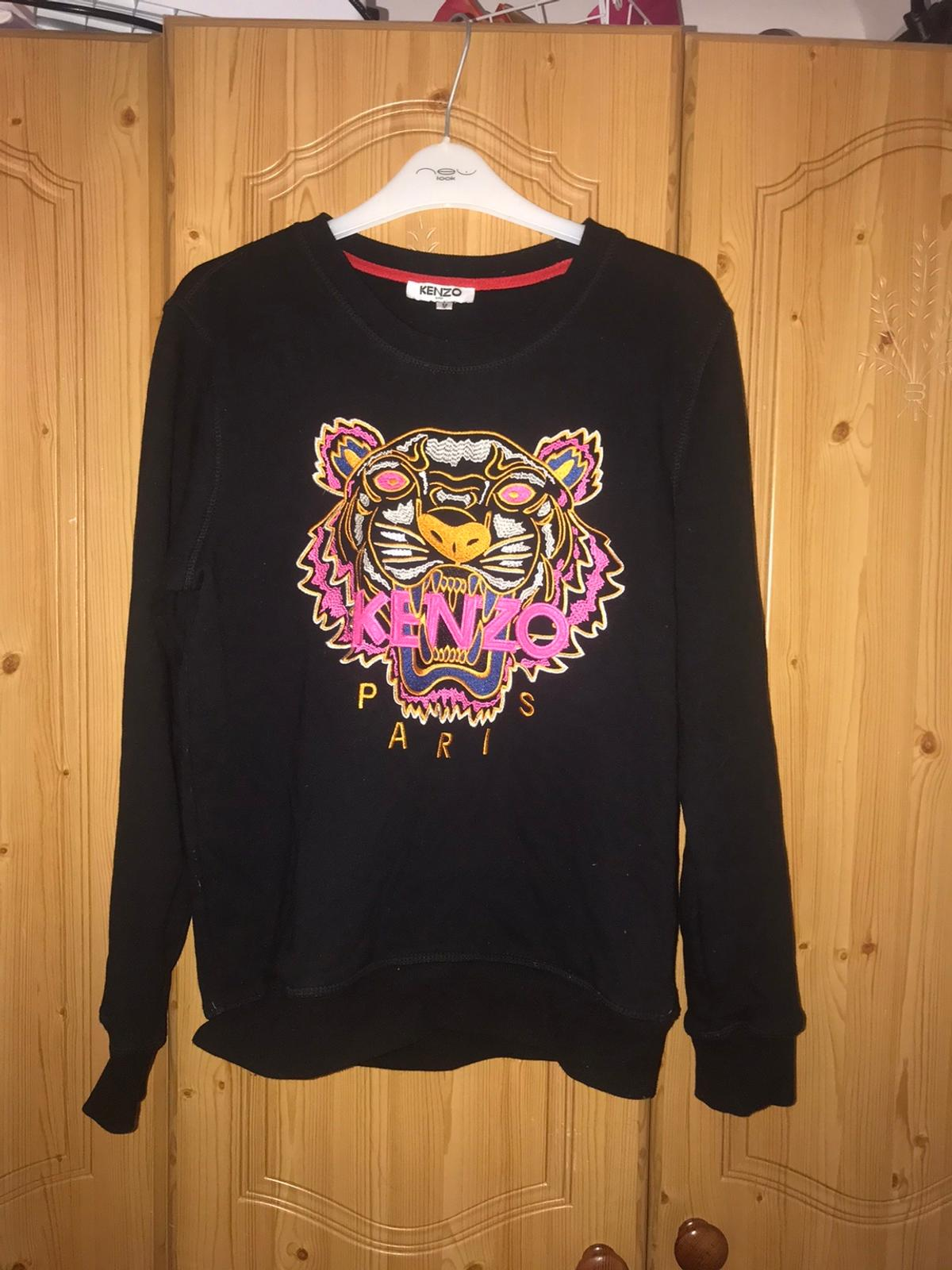 Women's authentic kenzo jumper. Size=medium, womens 8 Worn one, brand new condition. Price is @ £60.00 but I am willing to take offers