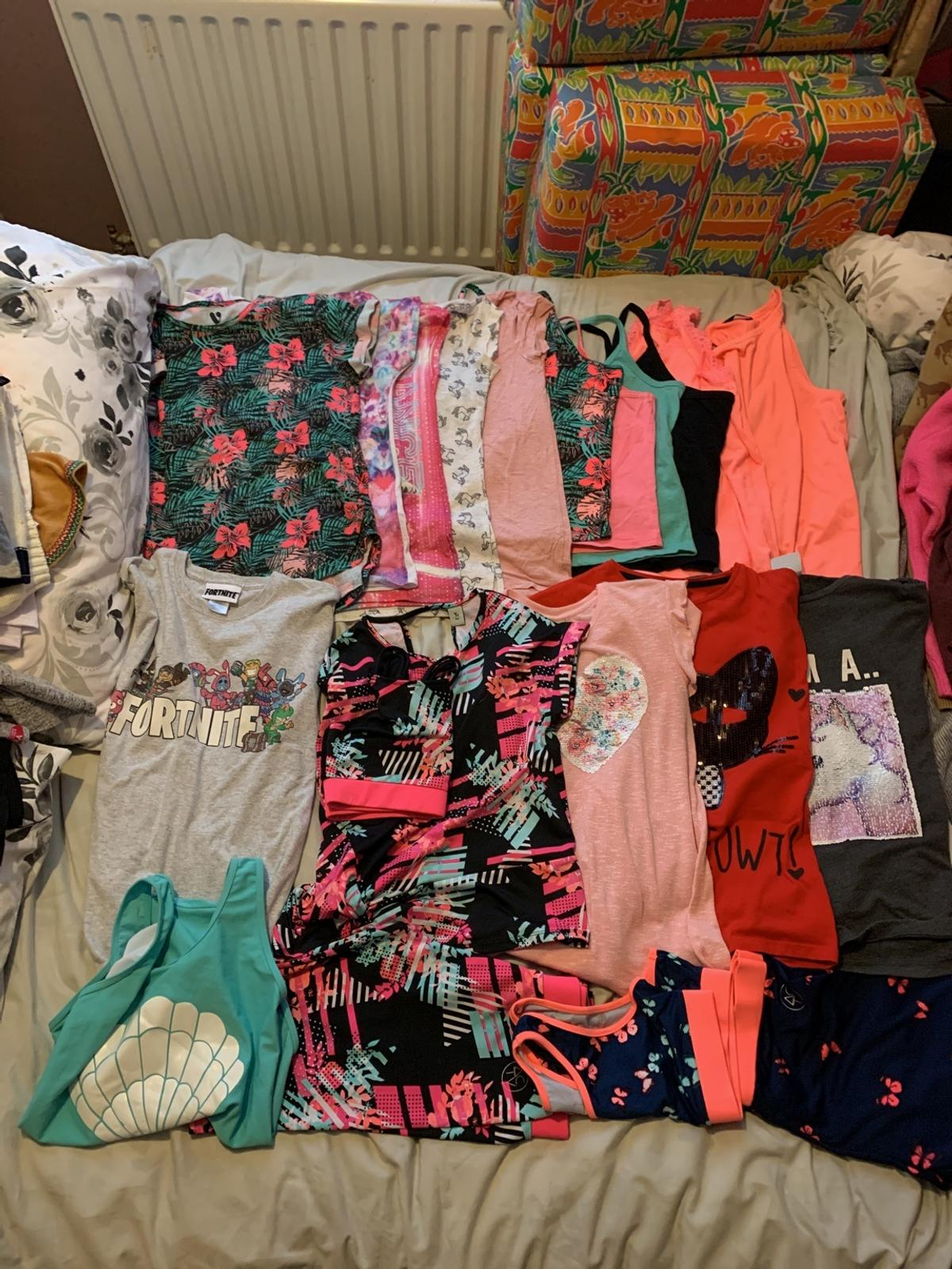 Girls clothes bundle in good condition includes 2x dresses, 4x jumpsuits, 10x t-shirts, 6x vest tops and more, over 40 items of clothing  UPDATE just found more clothes including 3x jeggings 3x denim shorts, 6x PJ's, 2x swimsuits and more Now more than 60 items of clothing