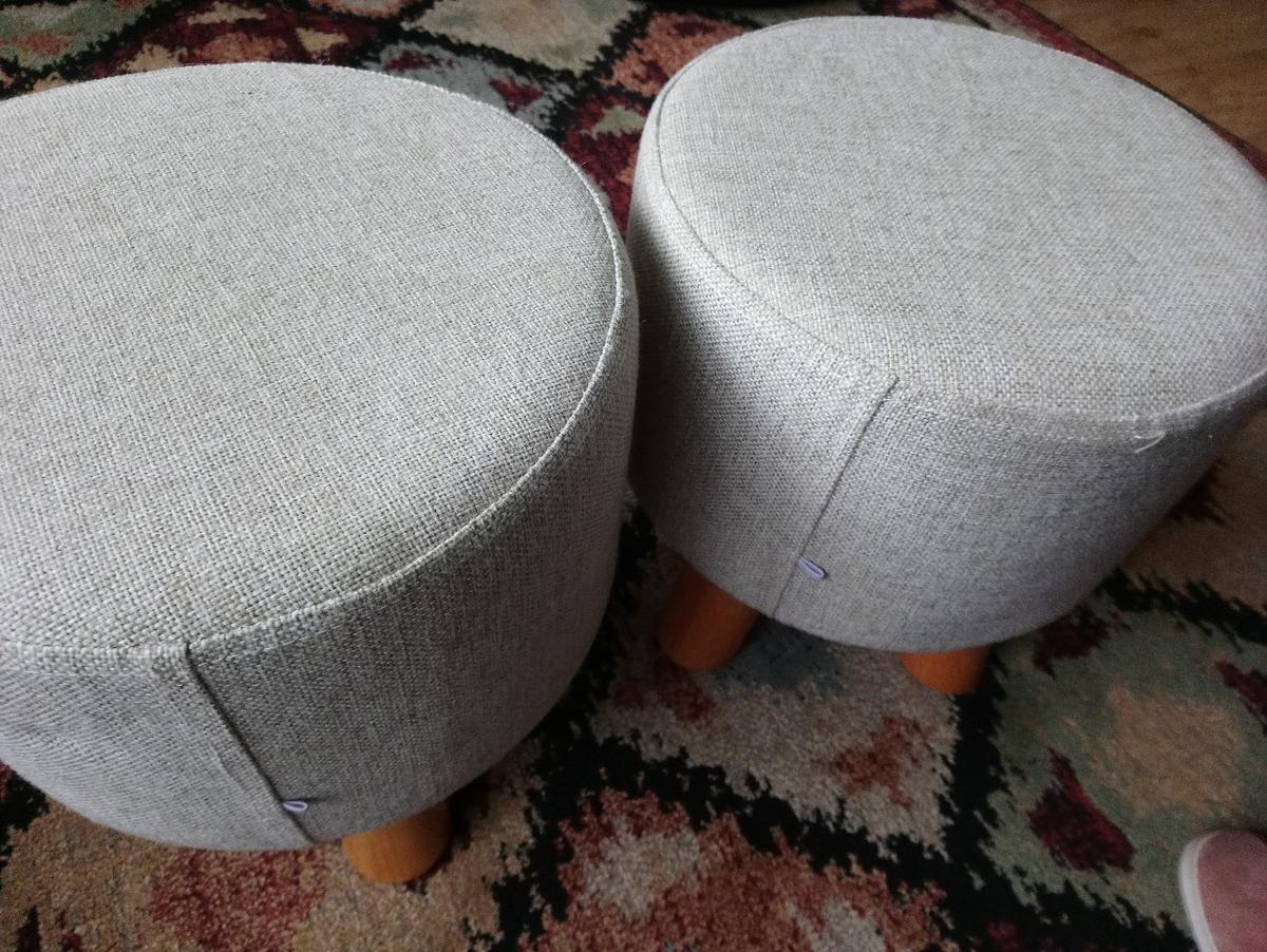 """One stool with removable cover for ease of washing. Beige woven textured cover with four wooden leg's. 11"""" high x 11"""". For collection by purchaser."""