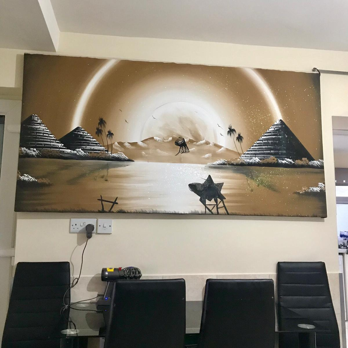 Have a blank wall? This Extra large Egyption art canvas is perfect.  The colours will give your surroundings a warm feel with the added sparkle for a grand look.  97 Length 190cm Width  Collection only