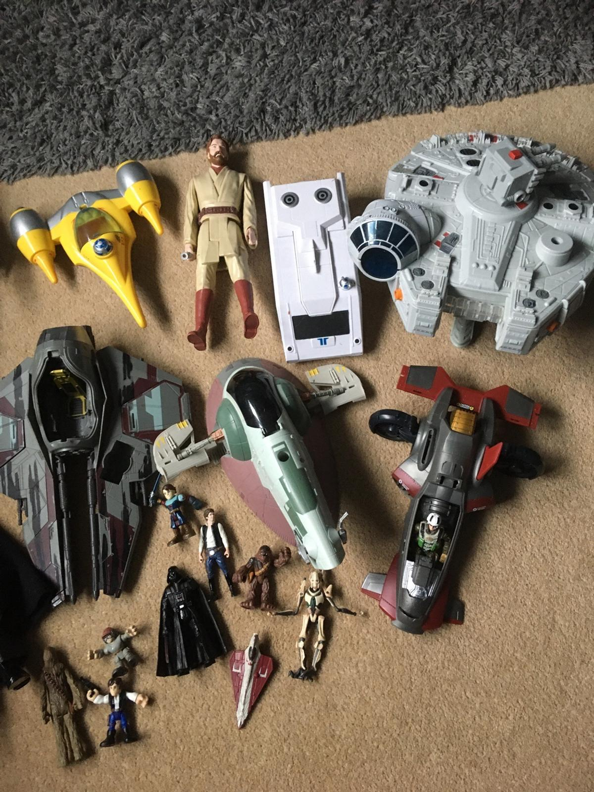4 large figures 7 small figures 5 spaceships 1 millennium falcon The green and brown spaceship and the small figure by it have been sold separately