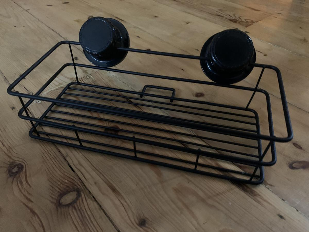 Black bathroom shower shelf  As pictured  Measures 30cm x 10cm x 5cm  Strong suction cups, no drilling required  BRAND NEW NEVER USED