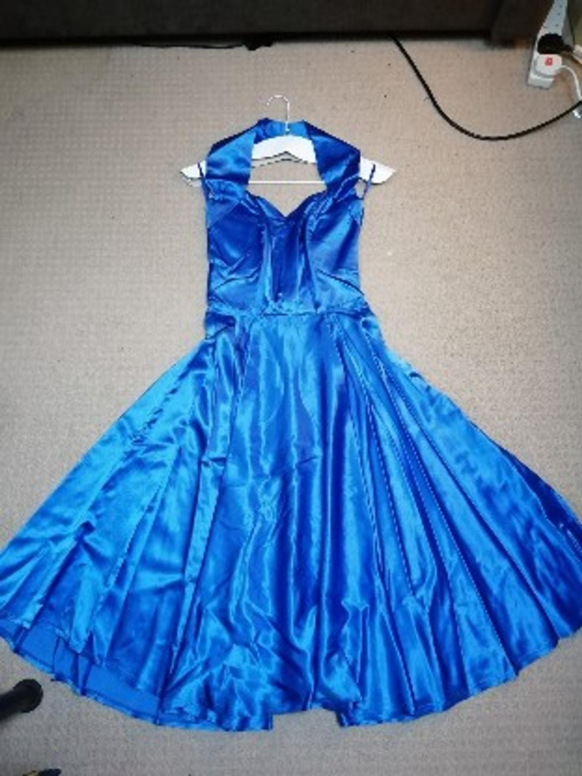 Royal blue satin halterneck dress with full circle skirt from Vivien of Holloway. Vintage 1950s style. Worn twice and dry cleaned. Straps have been adjusted but the seam can be unpicked. Perfect for weddings. Comes with full circle petticoat.